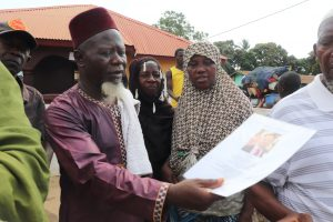 The Water Project:  Chief Imam Looking At Miralems Picture