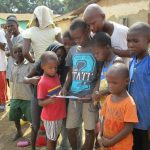 The Water Project: Lungi, Masoila, #3 Kamara Street -  Children Look At Miralems Picture