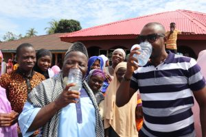 The Water Project:  District Council Representative And Community Leader Drinking The Clean Water From The Well