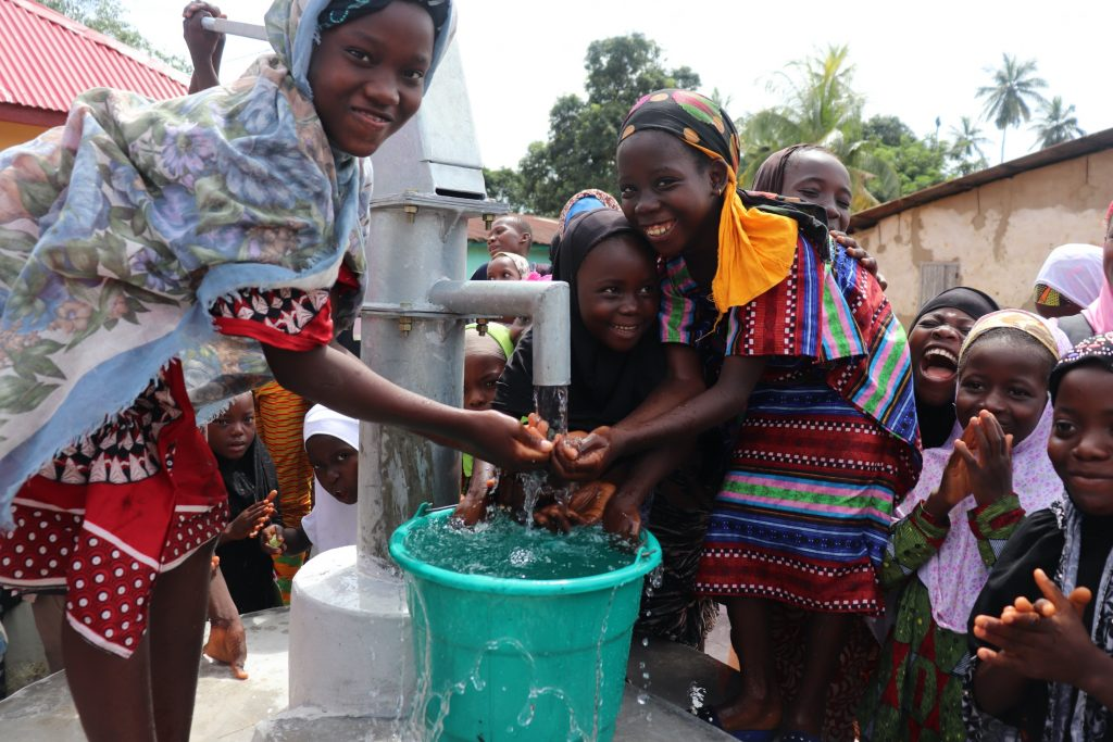 The Water Project : sierraleone19284-girls-celebrate-at-the-well