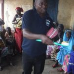 The Water Project: Lungi, Masoila, #3 Kamara Street -  Hygiene Facilitator Discusses Toothbrushing