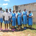 The Water Project: Gimarakwa Primary School -  Students Pose At School Gate