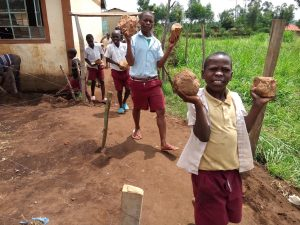 The Water Project:  Pupils Carry Stones For Construction