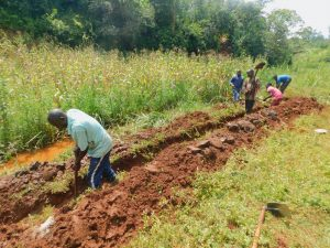 The Water Project:  Constructing Drainage Channel