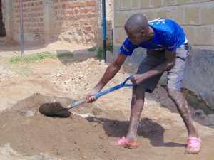 The Water Project:  Student Helps Mix Cement
