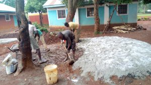 The Water Project:  Mixing Concrete For Foundation