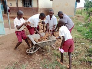 The Water Project:  Pupils Help Collect Stones For Rain Tank Foundation