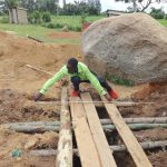 The Water Project: Mwichina Primary School -  Artisan Measures Latrine Foundation Over Pits