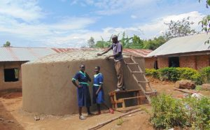 The Water Project:  Girls Pose With Rain Tank In Progress