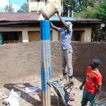 The Water Project: Kerongo Secondary School -  Pouring Cement Of Central Pillar