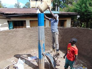 The Water Project:  Pouring Cement Of Central Pillar