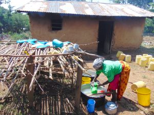 The Water Project:  School Cook Washes Dishes At Dishrack