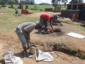 The Water Project:  Mixing Materials As Latrine Corner Begins In Background