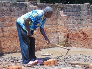 The Water Project:  Mixing Concrete Latrine Foundation