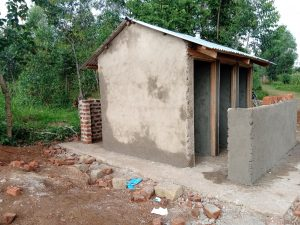 The Water Project:  Latrines Receive First Cement