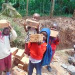 The Water Project: Shivembe Community, Murumbi Spring -  Students Deliver Bricks To Site