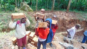 The Water Project:  Students Deliver Bricks To Site