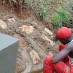 The Water Project: Kimarani Community, Kipsiro Spring -  Cementing The Rub Walls