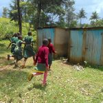 The Water Project: Wavoka Primary School -  The Girls Rushing To Their Latrines