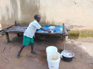The Water Project:  Pupil Takes A Cup From The Dishrack