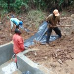 The Water Project: Kisasi Community, Edward Sabwa Spring -  Adding The Plastic Tarp