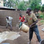 The Water Project: Kerongo Secondary School -  Mixing Outer Cement After Sugar Sacks Removed