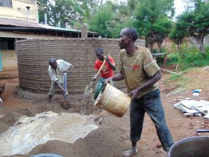 The Water Project:  Mixing Outer Cement After Sugar Sacks Removed