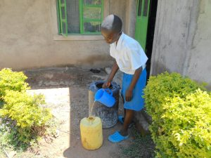 The Water Project:  Student Collecting Water From Home