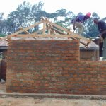 The Water Project: Kosiage Primary School -  Adding Timber Frames To Latrines