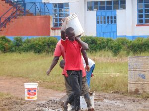The Water Project:  Carrying Materials To Latrine Site