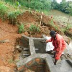 The Water Project: Malimali Community, Shamala Spring -  Cementing Spring Walls