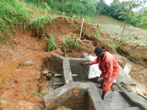 The Water Project:  Cementing Spring Walls