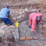 The Water Project: Bumira Community, Imbwaga Spring -  Rub Wall Stone Pitching
