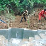 The Water Project: Kisasi Community, Edward Sabwa Spring -  Soil Backfilling Over Tarp