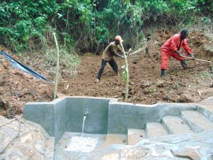 The Water Project:  Soil Backfilling Over Tarp