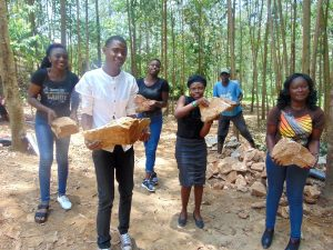 The Water Project:  Interns Help Carry Stones To Site
