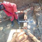 The Water Project: Shivembe Community, Murumbi Spring -  Pipe Setting