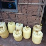 The Water Project: Saosi Primary School -  Water Storage Containers Outside Kitchen