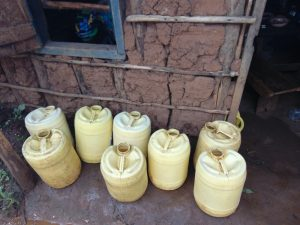 The Water Project:  Water Storage Containers Outside Kitchen