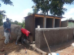 The Water Project:  Latrine Cement Work