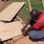 The Water Project: Banja Secondary School -  Planing Latrine Doors