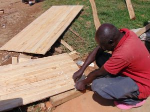 The Water Project:  Planing Latrine Doors