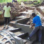 The Water Project: Buyangu Community, Mukhola Spring -  Outside Plastering