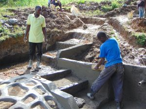 The Water Project:  Outside Plastering
