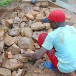 The Water Project: Kimarani Community, Kipsiro Spring -  Backfilling With Stones