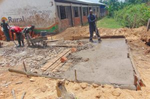The Water Project:  Pouring Latrine Foundation Over Pits