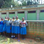 The Water Project: Shikomoli Primary School -  Girls At Their Latrine Block