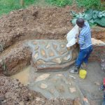 The Water Project: Bumira Community, Imbwaga Spring -  Plastering The Rub Walls