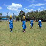 The Water Project: Gimarakwa Primary School -  Students Bringing Water To School