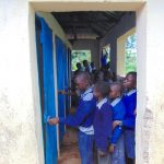 The Water Project: Saosi Primary School -  Boys Queueing To Use Latrines